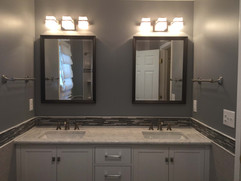 bathroom remodel with double sink and double vanity