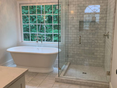 bathroom renovation project with bathtub and glass shower