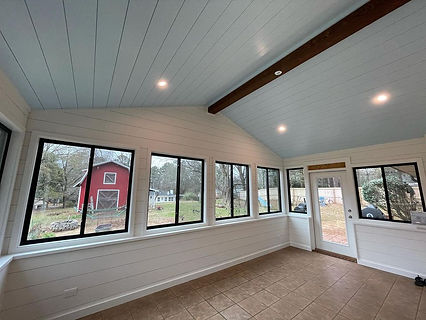 interior view of farmhouse style white sun room home addition remodeling project