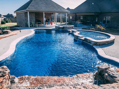 fiberglass pool with hot tub built by Butler Pool and Spa