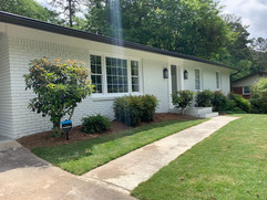 exterior view of remodeled white brick ranch