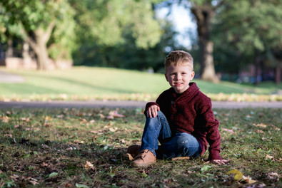 Fall outside photo session of a child