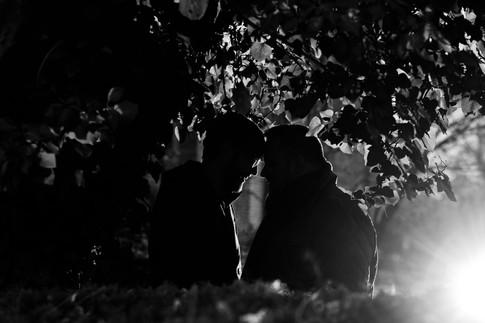 Dramatic black & white couple portrait with lighting.