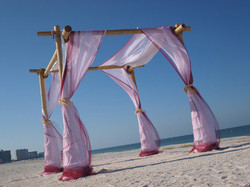Bamboo archway with sheer draping