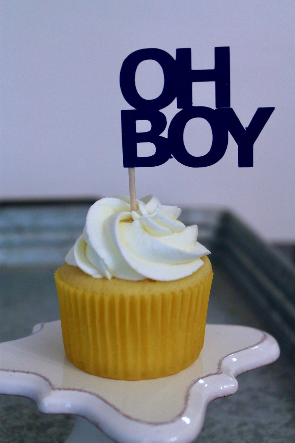 Lemon Buttercream Cupcake with topper