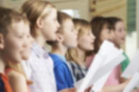 bigstock-Group-Of-School-Children-Singi-