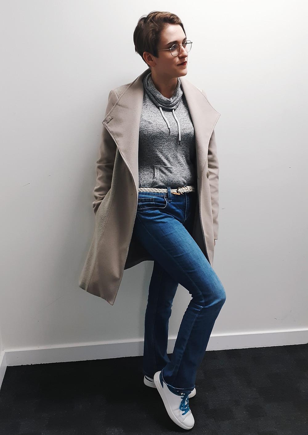 long coat grey jumper dark blue jeans