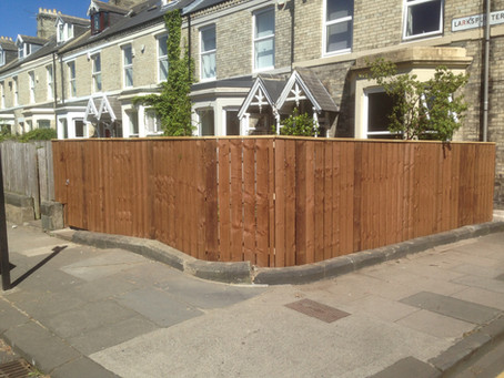 Space boarded fence with matching gate and capping