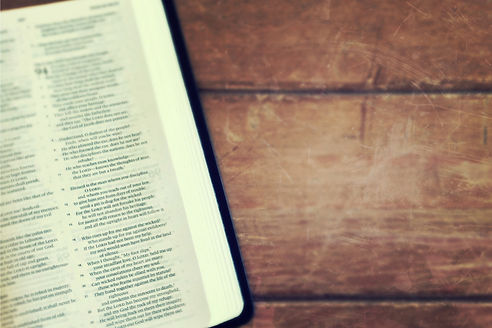 bible and wooden background