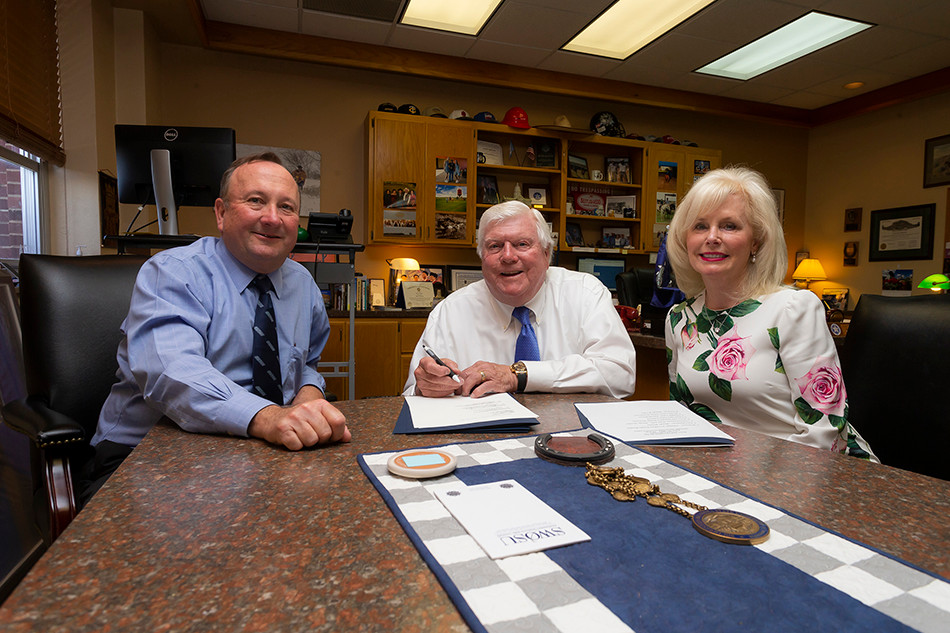 From the right: Margaret and Jerry Hodge with SWOSU President Randy Beutler.