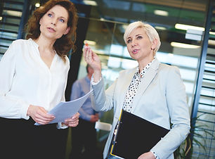 two women talk through sales training in