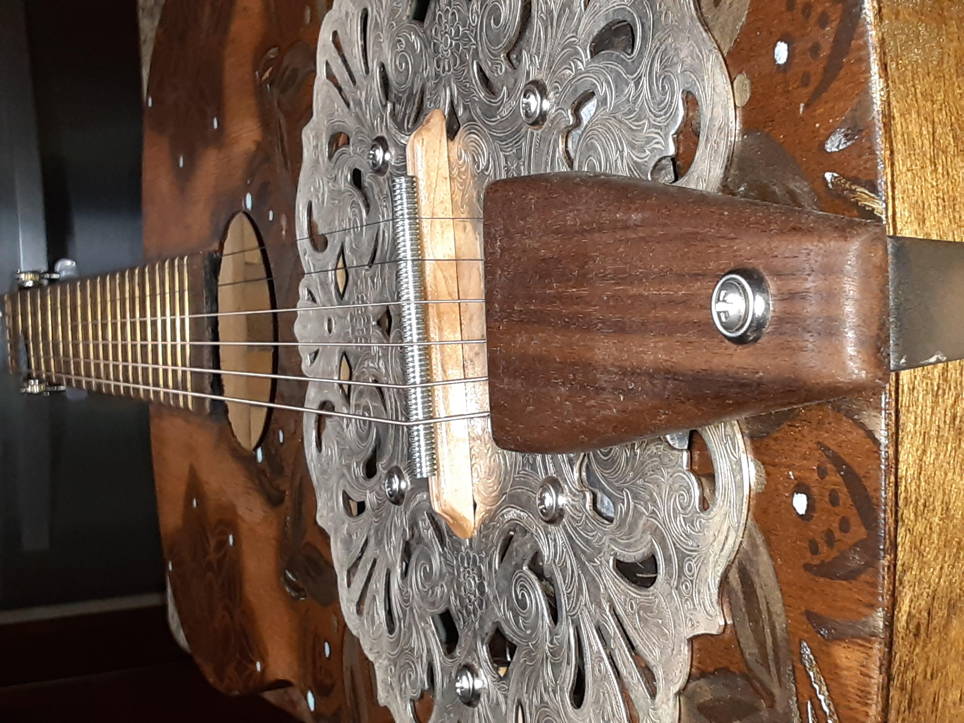 Hand-carved walnut tailpiece & maple bridge