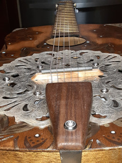Hand-carved walnut tailpiece & maple bridge