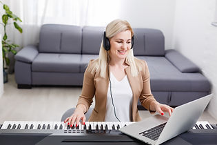 woman musician playing classic digital piano at home during online class at home, social d