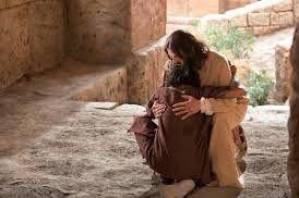 Jesus hugging begger