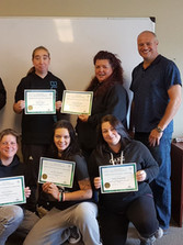 Valemount students showing off their certificates, and celebrating their graduation from the QUEST plus Environmental Monitoring program.