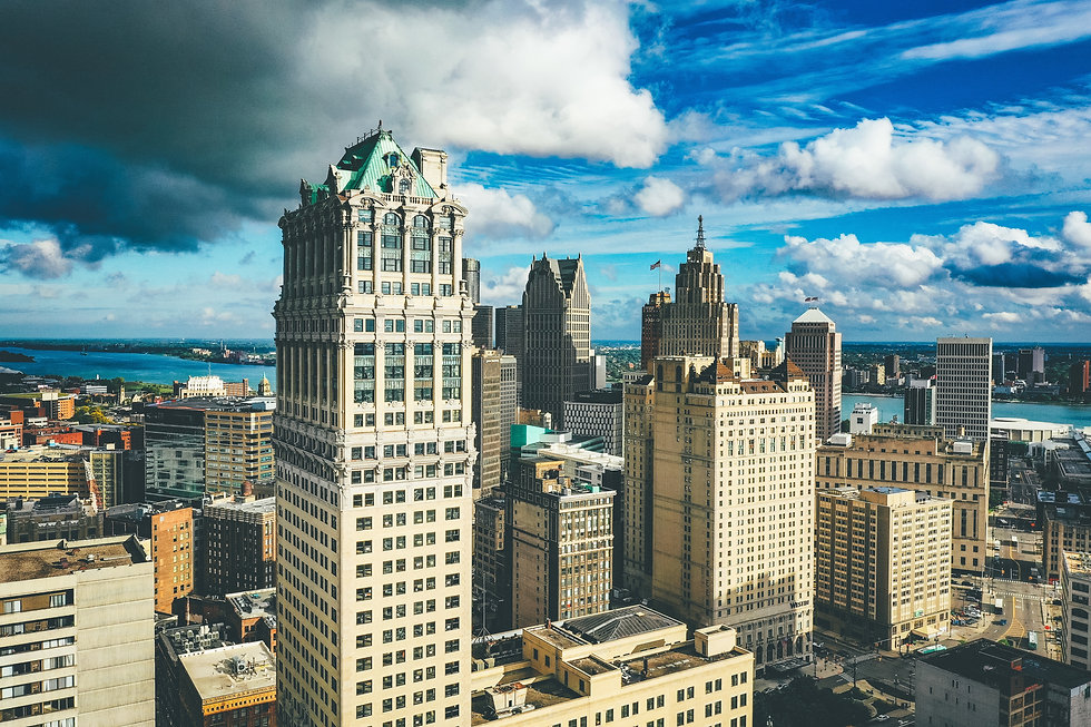 cityscape-detroit-sunlight-dark-cloudy-s