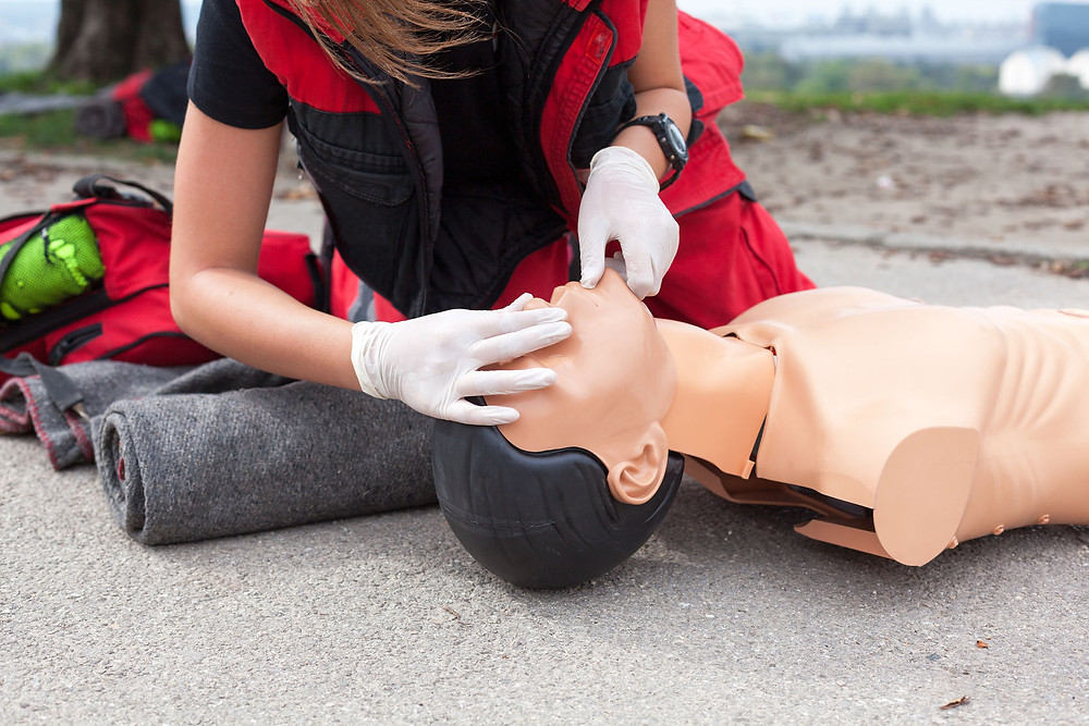 first aid training on a mannequin