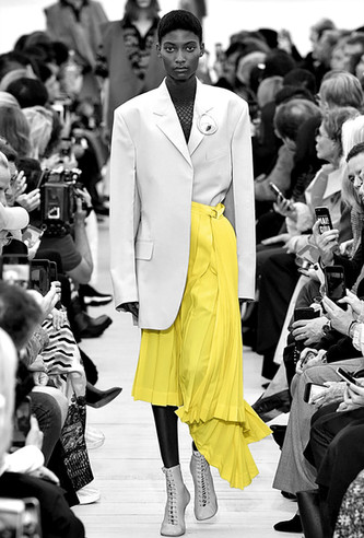 black and white with colour yellow skirt walking on the catwalk summer outfit fashion inspiration wonk magazine