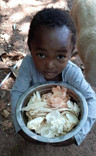 Kessie and a bowl of freshly harvested mushrooms.