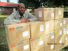 Eliudi With Boxes of Radios.JPG