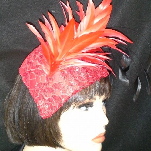 Red fascinator with red feather