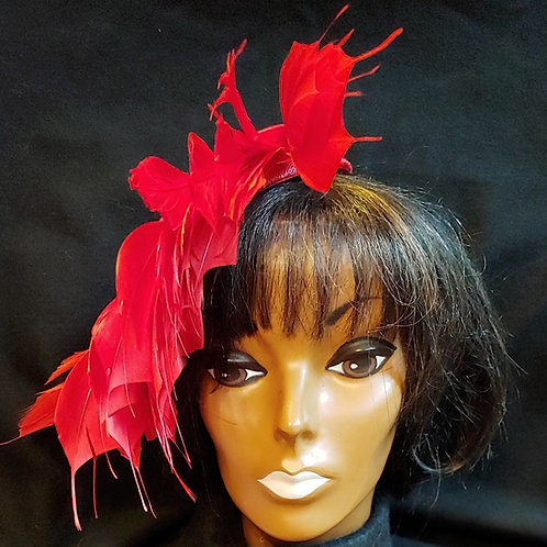 Red sinamay covered feather fascinator