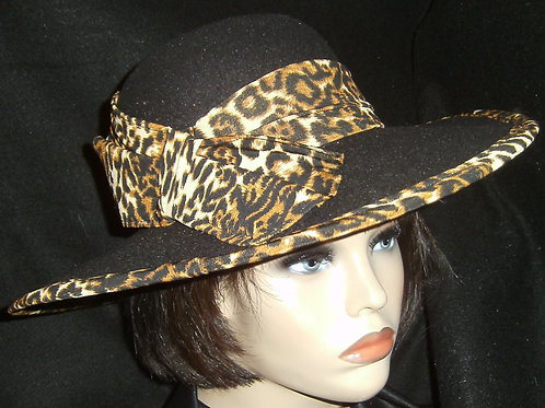 Black hat trimmed with animal print