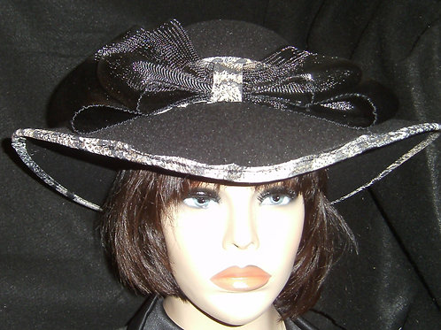 Black hat trimmed with animal print fabric.