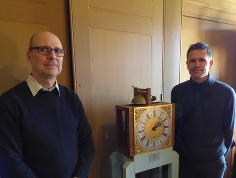 Matthew King with his 1713 Harrison replica clock movement, exhibited at Nostell Priory in Wakefield, with artist Luke Jerram