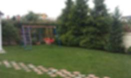 Детская площадка в дизайне участка