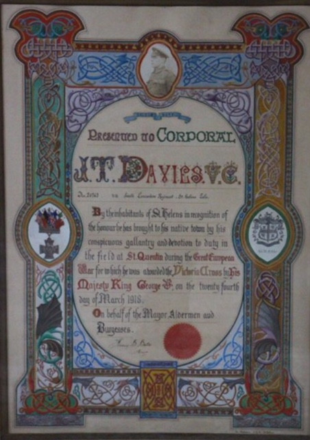 Illuminated scroll presented to Cpl Davies on behalf of the people of St.Helens
