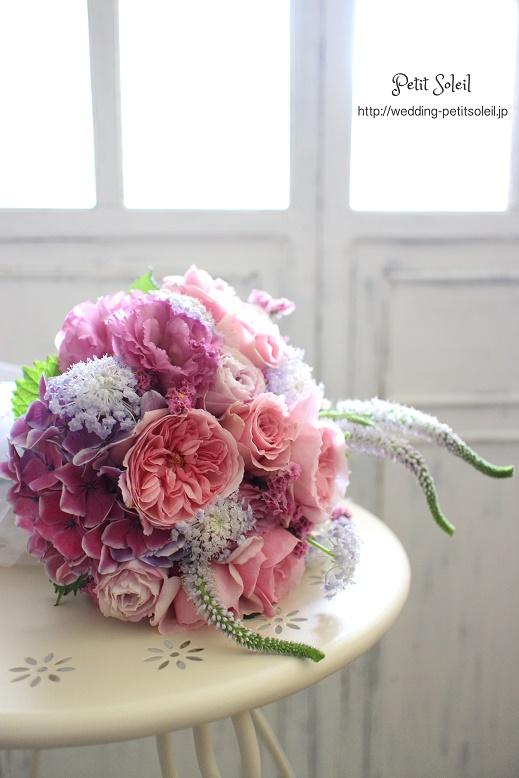 154.ピンクと紫のクラッチブーケ