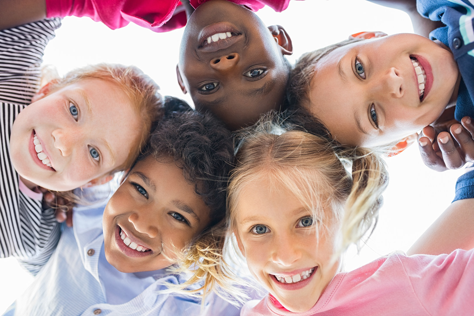 Closeup face of happy multiethnic childr