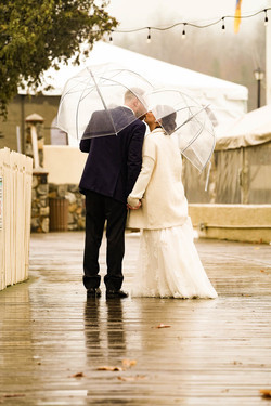 Bride & Groom Kiss In The Rain