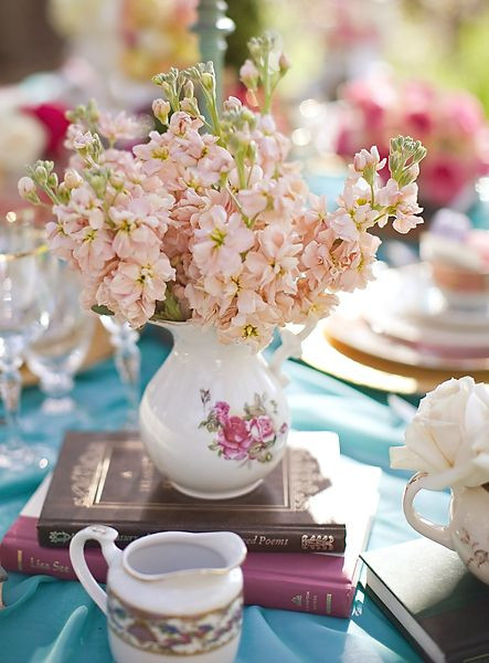 floral centerpiece on top of books