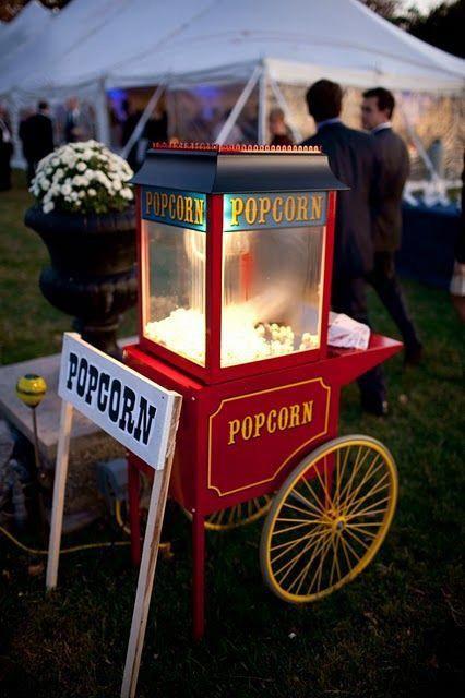 Popcorn stand in a garden wedding reception