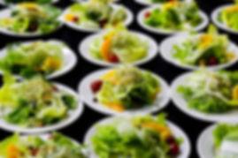 plated mixed greens salad ith mango and alfalfa sprouts