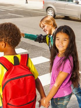 children walking at crosswalk.png