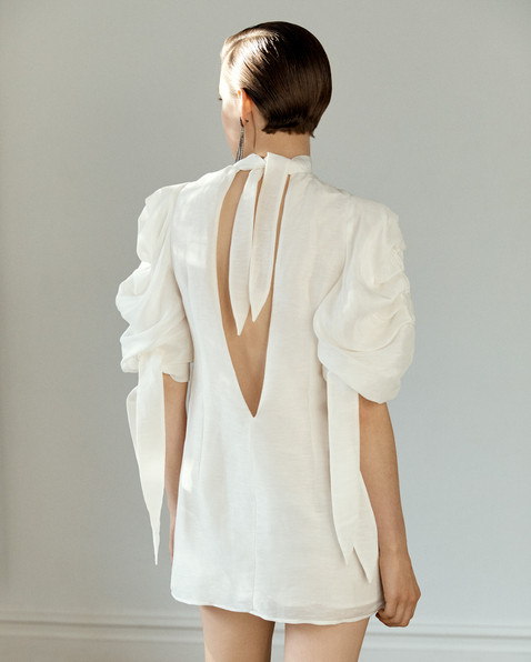 POMPOUS OPEN BACK MINI DRESS_WHITE_MODEL