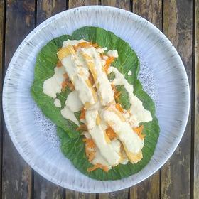 GLUTEN FREE/VEGAN Serves 2 200g firm tofu · 4-6 large spring green leaves · Tahini · Lime · Jalapeños · Green chillies (optional) · 1...