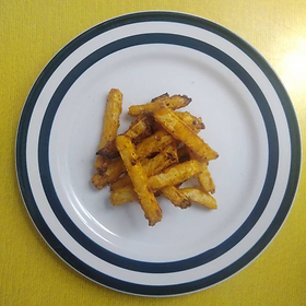 Chips- but made from swede! Just as good with a bit of ketchup. Serves 2  (multiply as necessary) · 200g swede · 1 tbsp Oil · Pinch of Sa...