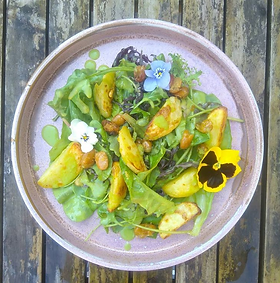 Salad leaves with Roasted lemon and Garlic potatoes. The creamy chive dressing is made with butter beans and can be made oil-free. Vegan....