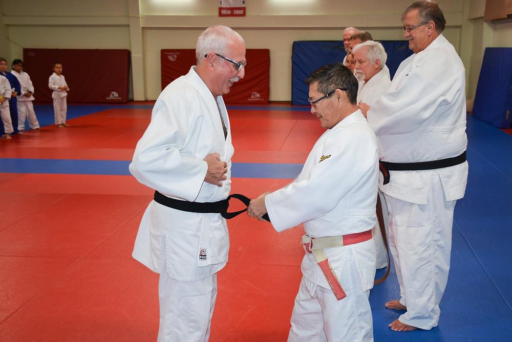 Sensei Frank Marrazzo receives his Black Belt from Sensei Mitchell Kawasaki