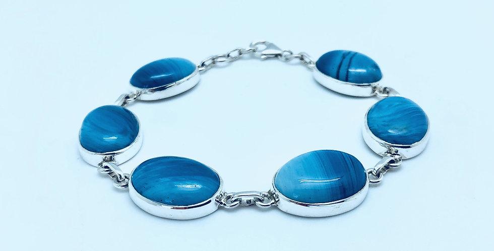Armband sex stenar