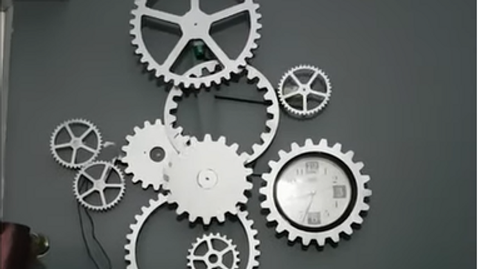 unique moving model design of a wall clock with wooden gears