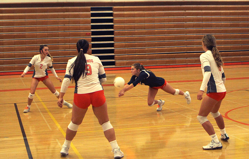 Greyhound volleyball players struggle to get footing