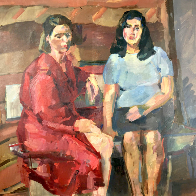 Two women seated on a bench