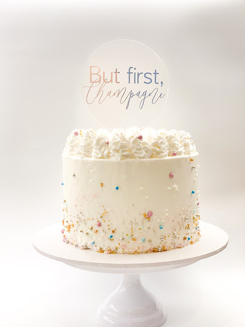 But first, champagne cake topper
