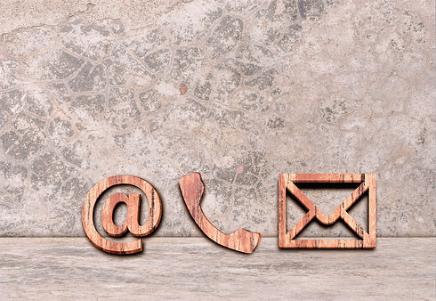 phone-email-and-post-icons-leaning-on-cement-wall-copy-space-contact-us_t20_kLjGk3_edited_edited.jpg